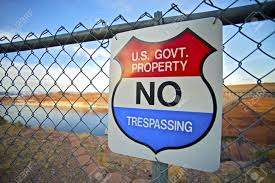 photo provided by http://www.123rf.com/photo_15485763_no-trespassing-us-government-property-warning-sign-on-fence.html